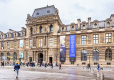 Architectural fragment of one of facades of the museum Louvre Stock Image