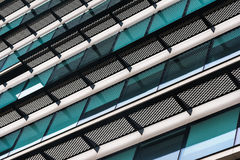 Architectural geometry. Metal, glass and plastic in modern architecture stock images