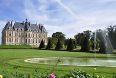 Small castle in large park with pond Stock Photography