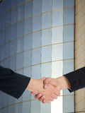 Architectural Handshaking in front of building Royalty Free Stock Images