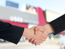 Architectural Handshaking in front of building Stock Image