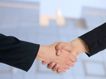 Architectural Handshaking in front of building Stock Photo
