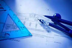 Architectural House Building Plans. Architectural plans to build a house with tools and a blue tone stock images