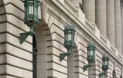 Architectural Lighting. Large, Ornate lights line the side of an historic building in Cleveland, Ohio Stock Images
