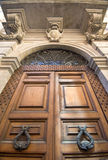 Architectural Magnificence. Just one of the numerous impressive looking doors and handles in Rome Royalty Free Stock Photo