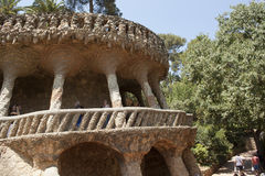 Architectural masterpieces of Antoni Gaudi in Guell park attract. BARCELONA, SPAIN - JULY 12, 2013: Architectural masterpieces of Antoni Gaudi in Guell park Stock Images
