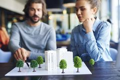 Free Architectural Model And Young Adults Architects In The Background Royalty Free Stock Image - 152912976