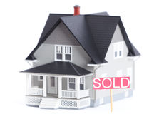 Architectural model with Sold sign, isolated Royalty Free Stock Photo