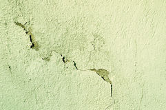 Architectural obsolete background - textured old stone wall with curved cracks and peeling aged stucco Stock Photography