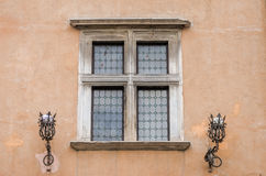 Architectural old retro vintage window in the house with metal lanterns for osveschaniya streets in the capital of Italy, Rome Royalty Free Stock Photos