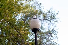 Architectural old street lights. Different light bulbs. Beautiful street light stock images