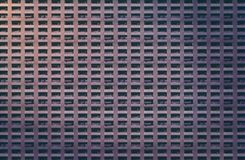 Dark concrete facade with balconies of a miserable house. Architectural pattern, dark concrete facade with balconies of a miserable house royalty free stock photos