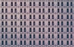 Window facade of an old miserable berlin house. Architectural pattern, window facade of an old miserable berlin house stock photography