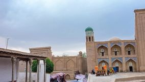 Architectural pearls of Khiva. KHIVA, UZBEKISTAN – MAY 3, 2015: The Madrassah of Kutlug-Murad-inak is the famous landmark of medieval town located next to the stock video footage