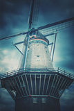 Architectural Photography of Wind Mill Under Cloudy Sky Stock Photography