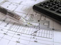 Architectural plan. Pencil and calculator on the architectural project stock image