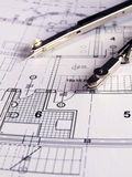 Architectural plan. Dividers laying on architectural project Stock Photos