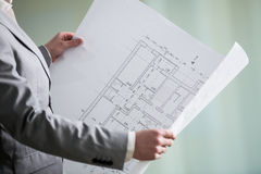 Architectural plan in the architect's hands Royalty Free Stock Images
