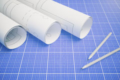 Architectural plan on blueprint. Paper rolls with architectural plan and pencils on blueprint pattern background. 3D Rendering Stock Image