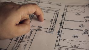 Architectural plan blueprint pointing with hand stock footage