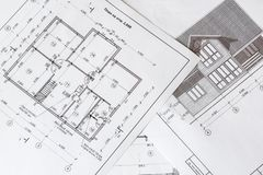 The architectural plan of the house is printed on a white sheet of paper. June 2018, Russia, Moscow royalty free stock images