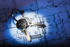 Architectural plan and keys. High contrast. Blue tint stock photo