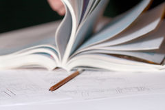 Architectural Plan With Open Book And Pencil Royalty Free Stock Image