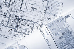 Architectural plans. Some architectural plans sitting on the table Stock Photo