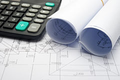 Architectural plans and calculator Royalty Free Stock Images