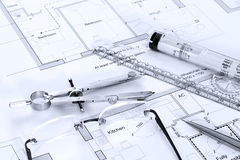 Architectural plans with drawing equipment. Still life photo of architectural floor plans with drawing instruments Stock Photo