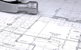 Architectural plans and hammer Stock Image