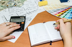 Architectural plans with palette of colors, money, calculator,