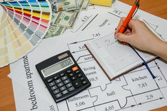 Architectural plans with palette of colors, money, calculator, Royalty Free Stock Photo