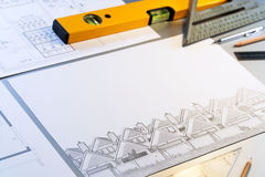 Architectural plans  with tools. Royalty Free Stock Images