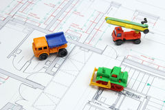 Architectural plans and toy bulldozer, dump truck Royalty Free Stock Photo
