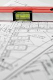 Architectural plans and water level. Water level and architectural plan , home building concept Stock Image
