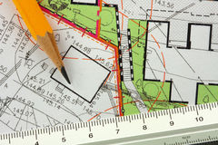 Architectural project. Pencil and ruler on architectural general plan stock photos