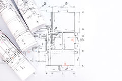 Architectural project, blueprint rolls on plan Stock Images