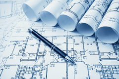 Architectural project, blueprints, blueprin. Architect workplace. Architectural project, blueprints, blueprint rolls on wooden desk table. Construction stock image