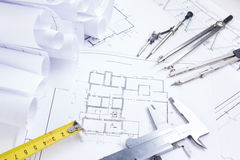 Architectural project, blueprints, blueprint rolls and divider compass, calipers, folding ruler on plans Engineering tools view fr. Om the top. Copy space Stock Images