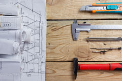 Architectural project, blueprints, blueprint rolls and divider compass, calipers on vintage wooden background. Construction. Concept. Engineering tools. Copy stock image