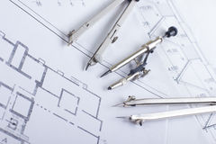 Architectural project, blueprints and divider compass on plans Engineering tools view from the top. Cop Royalty Free Stock Image