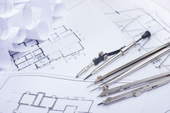 Architectural project, blueprints and divider compass on plans Engineering tools view from the top. Cop Stock Image