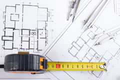 Architectural project, blueprints and divider compass on plans Engineering tools view from the top. Cop Stock Photos