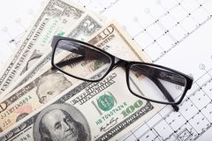 Architectural project and money with glasses. Construction background royalty free stock photography