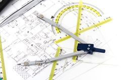 Architectural project, pair of compasses, rulers and calculator Royalty Free Stock Photo
