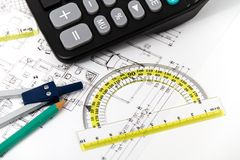 Architectural project, pair of compasses, rulers and calculator Stock Photography