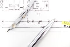 Architectural project, pair of compasses, rulers and calculator Royalty Free Stock Image