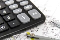 Architectural project, pair of compasses, rulers and calculator Stock Images