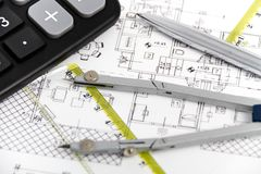 Architectural project, pair of compasses, rulers and calculator Stock Photo
